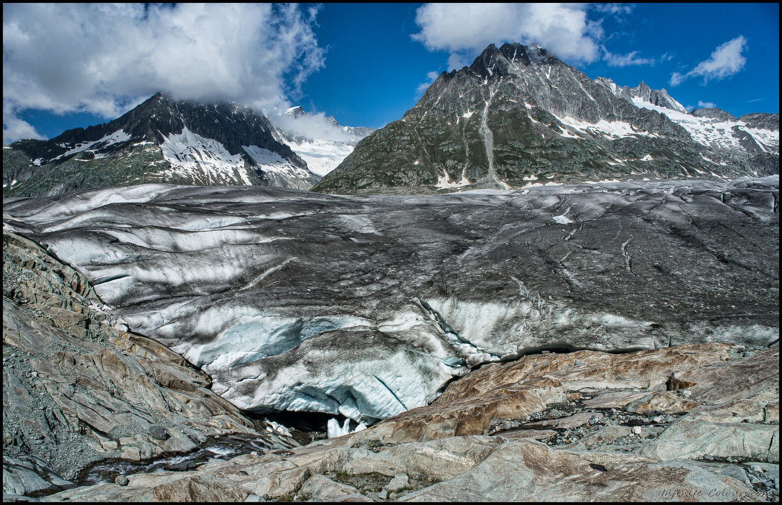 The outlow of the Märjelensee vanishes in the massive glacier