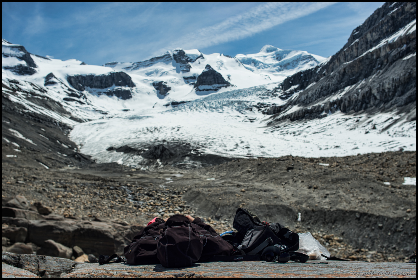 Taking a nap at the foot of Robson glacier, Berg Lake