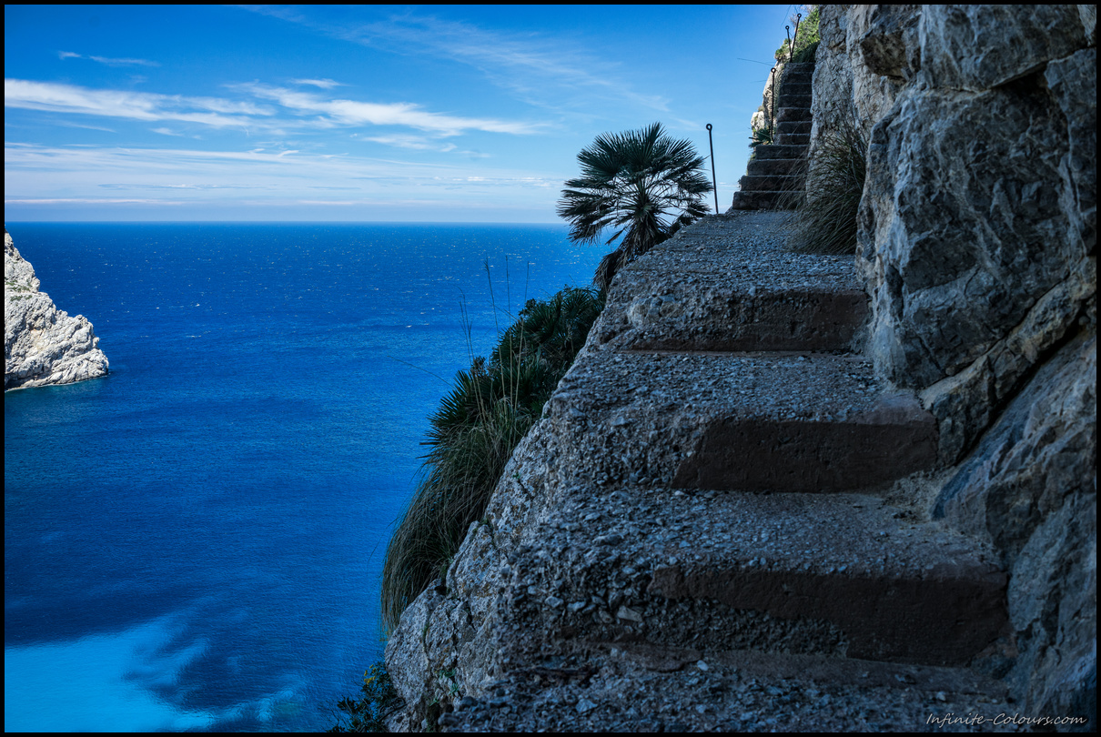 Quite exposed stone steps leading up the cliff over Cala Figuera