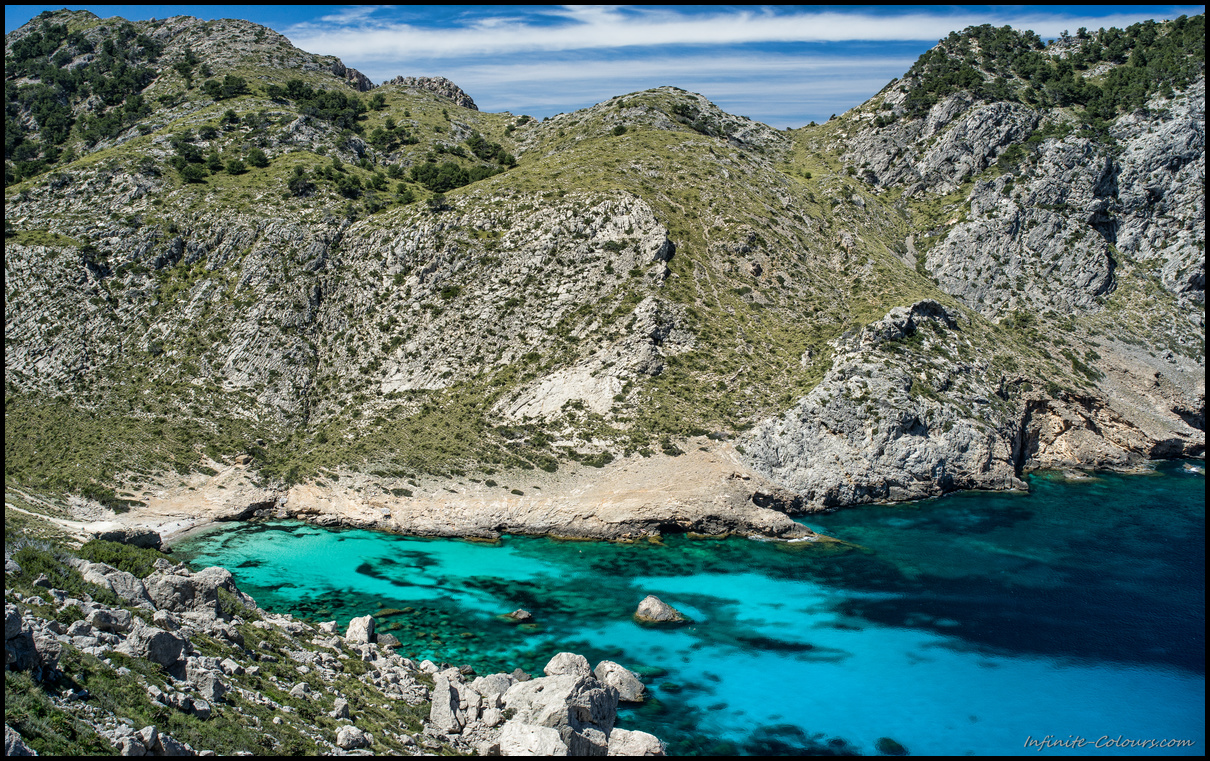 Shades of blue at Cala Figuera, is a stunning bay with turquoise waters
