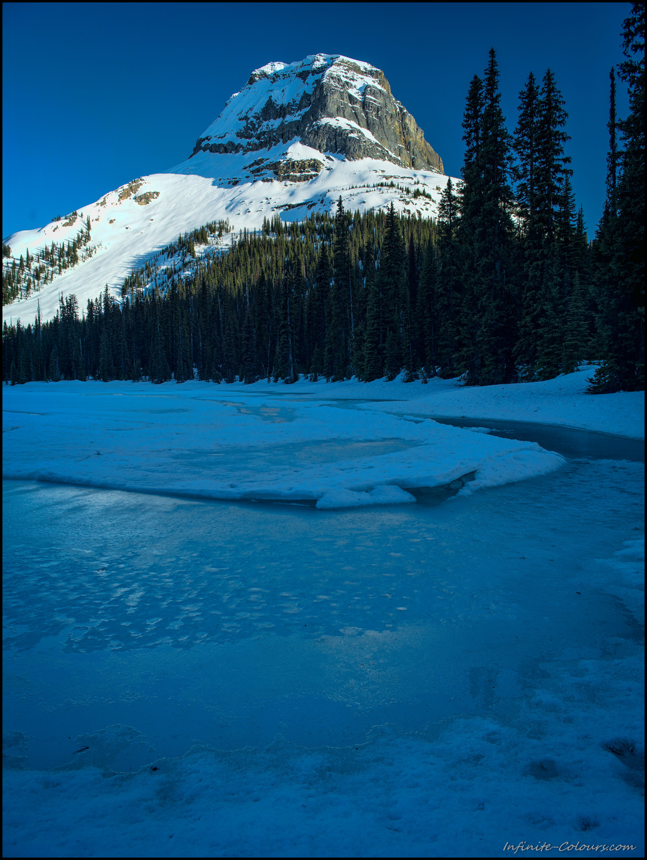 Last light at frozen Yoho Lake Winter Camping